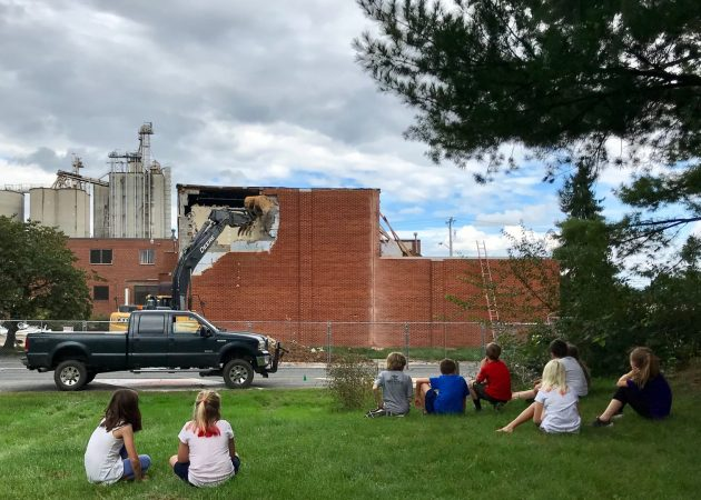 Elementary students watch the demolition of the music studio at the former MennoMedia building, which is being renovated to house Eastern Mennonite K-5 program. Photo by Heidi Byler.