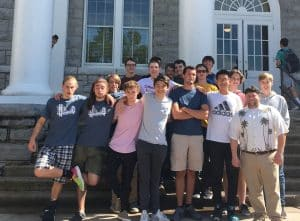 Kevin Carini, front right, took Robotics II students to JMU earlier this fall to visit their 3D printer lab.