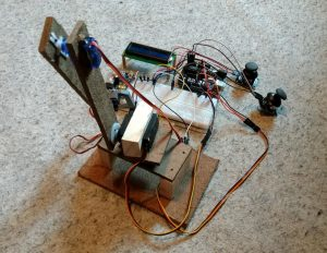 """Lleyton Stutzman '21 built these robotic arms controlled with Arduinos, a circuit board that can be used to control motors, sensors, and more. """"I constructed it with masonite, wood, a 3-D printed claw, and servo motors for the moving parts,"""" he says. """"Overall I am happy with my end result, but the claw is too weak to pick up anything."""""""