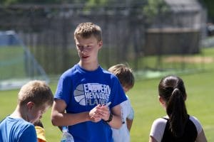 Older students help out at the elementary school's annual field day.