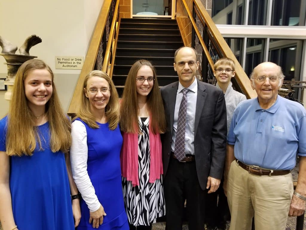 Julie Weaver '20 (center) is inducted into NHS. On left, sister Jenna '21 and mother Rachel. To her right, father Mike '86 and EMS board of trustees, brother Jameson ''24 and grandfather Sam, former EMHS principal.