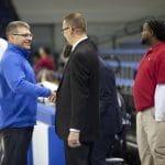 Dave Bechler congratulates Coach Chad Seibert after the boys varsity basketball state final win, 2019.