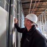 Matt Weaver signs a blessing wall
