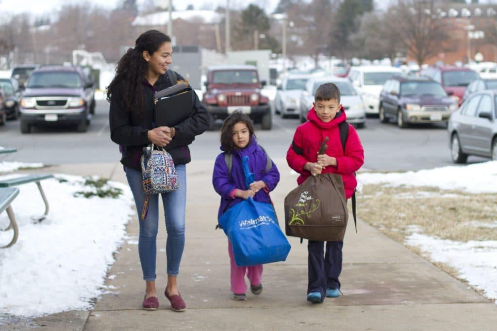 Amanda, grade 12, and siblings Ana, kindergarten, and Samuel, grade 3.