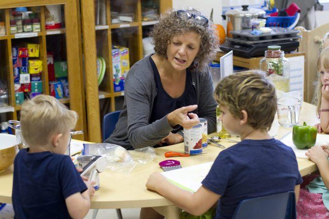 Lynette Mast often facilitates snack preparation with the kindergarten class.