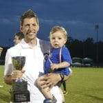Andrew celebrates state soccer win with Forrest, 2015