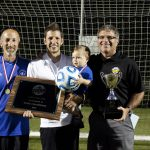 Curt Stutzman, assistant coach; Andrew Gascho, head coach, Forrest and Dave Bechler , athletic director, after the girls varsity state championship title game, 2015 championship plaque for girls soccer, 2015