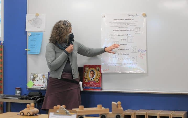 Lynette Mast reviews the kindergarten classroom Peace Pledge, signed at the beginning of the year