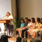 Jodi Beachy, fifth grade teacher, shares comments of affirmation and appreciation about each graduate.