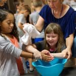 Washing each others' hands as a symbol of service to others