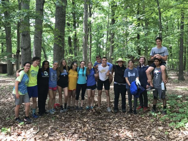 Track and Field team volunteers at Massanutta Springs as part of Community Service Day.
