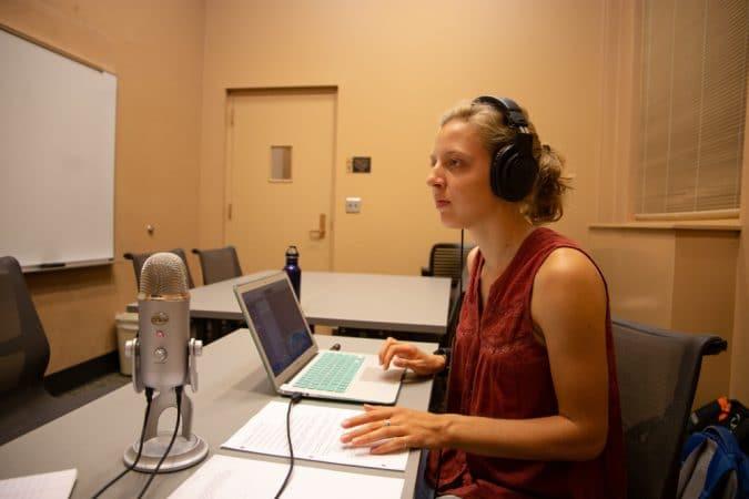 Michaela Mast '13, recording the podcast, Shifting Climates. Photo by Sarah Longenecker