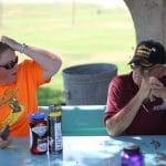 Jennifer Young, who drove the food and supply van for Discovery 2019 and '17, confers with bus driver Barry Darr over a lunch break in Yuma, Arizona.