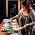 Kirsten Moore puts finishing touches on a dish for a Sub Rosa meal
