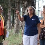 Kendal Bauman, Maria Archer and Lynette Mast consult about the elementary playground plans