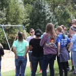 Seventh grade earth science class discusses how to incorporate salvaged tires into the elementary playground