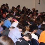 Students grades 6 to 12 prayer at the close of chapel