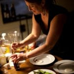 Kirsten Moore prepares plates for a Sub Rosa meal
