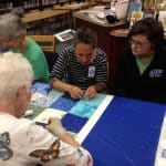 Volunteers -- including aunts, grandmothers, mothers and friends of current students -- helped with the quilting on History Day 2017