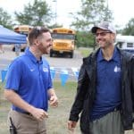 Justin King, high school principal, and Paul Leaman, head of school at the  2019 EMHS cross country invitational.