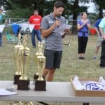 Andrew Gascho reading out awardee names at the  2019 EMHS cross country invitational at Peak View.