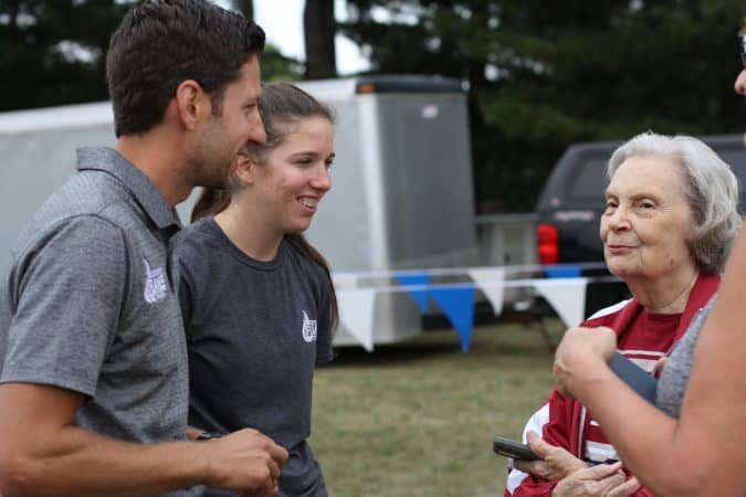 Andrew Gascho and crosss country coach, Katie Cimini, visit with Mrs. Burtner of the Burtner Farm cross country course in Penn Laird.