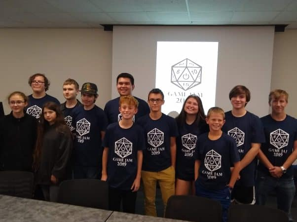 Mason Ritchie '23, second from back on the right, and his teammates who took third in the 2019 Game Jam coding event at JMU.
