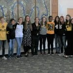 Students wear Mrs. Shannon Roth's (center) Iowa garb.