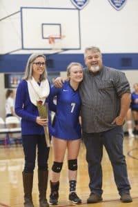 Maya Ferrell '20 with mom and dad, Sara and Joe