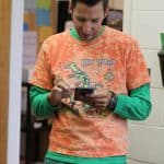Athletic Director Andrew Gascho, checking some stats on tie dye day during spring 2019 spiit week.