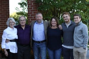 Kirsten Nafziger '89 Moore, third from right, with her family, including parents Helen and Ken Nafziger, husband Chris, and sons Max and Simon
