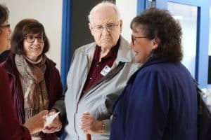 Lyle Burkholder '44 (center)