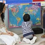 Babar family visit to kindergarten room to talk about their home country of Pakistan and share some special food.
