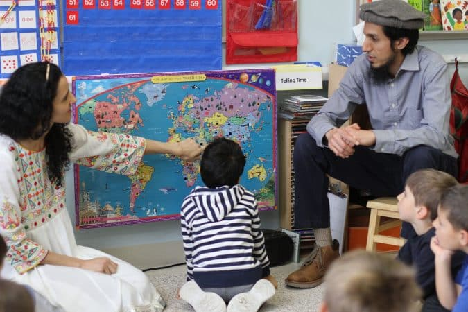 Babar family visit  kindergarten room to talk about their home country of Pakistan and share some special food.