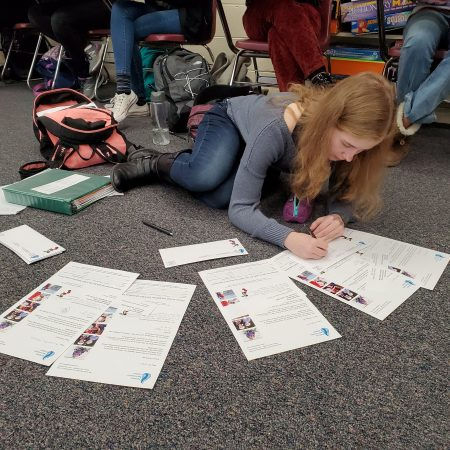 Maira Myers, class of '19, writing letters during Shannon Roth's government class where students reviewed the importance and how tos of civic engagement.