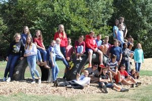Middle school science students helped install tires for the new EMES playground.
