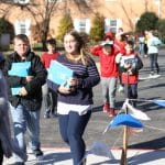 Elementary students take loads of supplies to the new school on Dec. 4 and 5