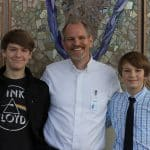 Christian Early, PhD, from James Madison University, and chapel speaker, with sons Joshua '24 (left) and Oliver '26 (right).