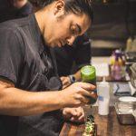 Luis Matinez '12 at work at the award-winning Eem Thai Barbeque restaurant in Portland, Oregon. Courtesy photo.