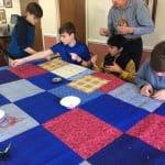 Seventh grade class. Comforter knotting for Mennonite Central Committee at Virginia Mennonite Retirement Community.