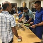 Paul Leaman, serves a omelet during the annual faculty/staff breakfast at the start of the 2018-19 school year.