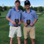 Meade Slonaker '20 and Adam Hatter '22, with their 2019 1st Team VIC Plaques