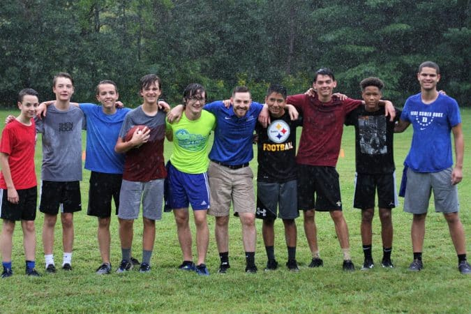 School Day Out at the beginning of each school year is a time to play and build relationships.   Pictured: high school students with Justin King, principal, August 2019 at Highland Retreat in Bergton, Virginia.