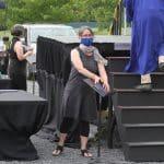 Jodi Herzler, senior class sponsor, preparing a diploma for socially safe pick up...Commencement 2020