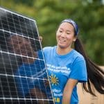 Eastern Mennonite University students help to install solar panels on a second campus installation in October 2018. Photo courtesy of Eastern Mennonite University.