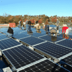 Volunteers install solar panels at Gift and Thrift, December 2019. Photo courtesy Green Hill Solutions.