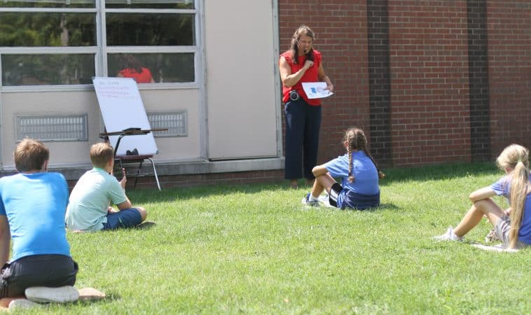 Rebecca Yutzy teaches a 7th grade Spanish class outside.