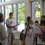 Middle school students enter through the Auditorium foyer