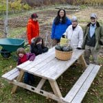 Ellen and Keith Helmuth at the Woodstock Community Garden with family gardeners, 2019.
