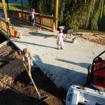 Spreading topsoil at the bridge